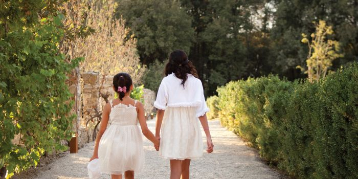 Girls in dresses walking together
