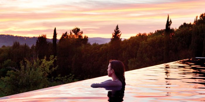 Lady in pool looking at sunset