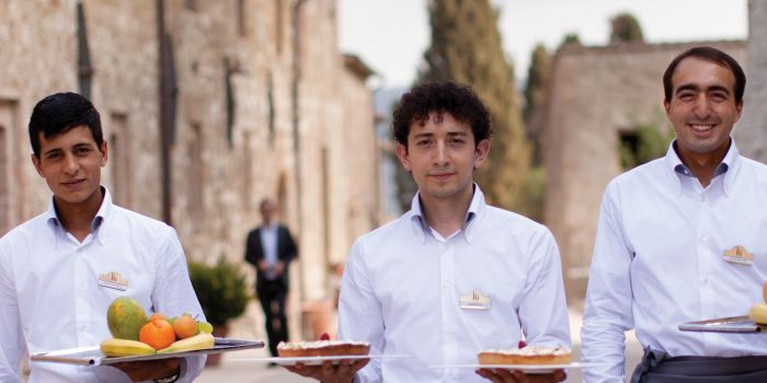 Waiters with food on plates